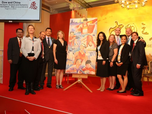 The OBE team posing with Greg's painting