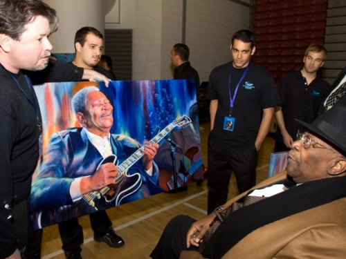 Greg backstage with B.B. King and Greg's portrait of the King of Blues