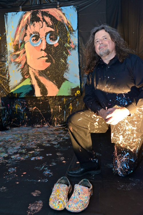 Greg Adamson next to his John Lennon painting
