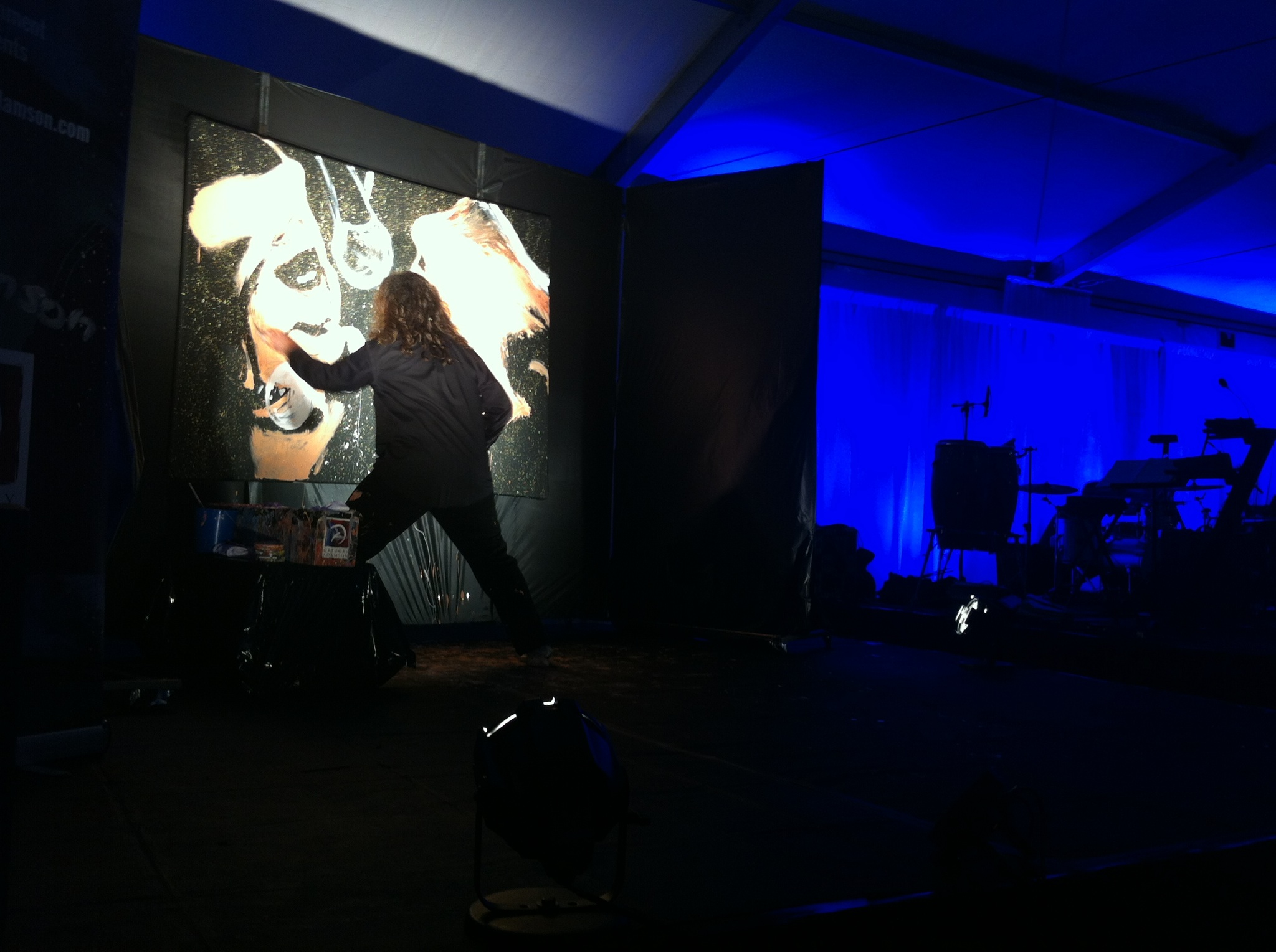 Gregory Adamson performance painting at a fundraising event
